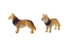 Geïsoleerd binnenlands hondstuk speelgoed Royalty-vrije Stock Afbeeldingen