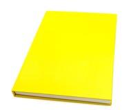 Geïsoleerd geel notitieboekje op wit Royalty-vrije Stock Foto's