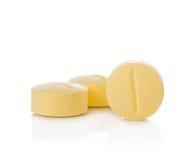 Geïsoleerd pillen geel royalty-vrije stock foto's