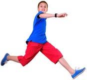 Geïsoleerd volledig lengteportret van lopende springende jongen Stock Foto