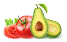 Geïsoleerde avocado en tomaten royalty-vrije stock afbeelding
