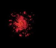 Geïsoleerde bloedvlek op zwarte Stock Foto
