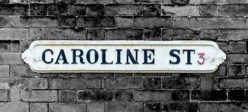 Geïsoleerde Caroline Street British Vintage Street-Tekens Stock Foto's