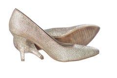 Geïsoleerde gouden schoenen Stock Foto's