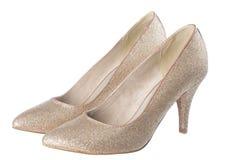 Geïsoleerde gouden schoenen Stock Foto