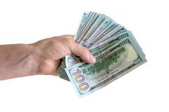 Geïsoleerde hand met pak van honderd dollars stock afbeelding