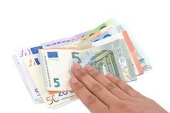 Geïsoleerde hand op Euro bankbiljetten op witte achtergrond Royalty-vrije Stock Afbeelding