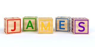 Geïsoleerde houten stuk speelgoed kubussen met brieven met naam James Royalty-vrije Stock Foto's