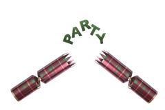Geïsoleerde Kerstmiscracker in geruit Schots wollen stofpatroon met partijtekst Stock Foto