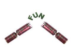 Geïsoleerde Kerstmiscracker in geruit Schots wollen stofpatroon met prettekst Stock Foto's