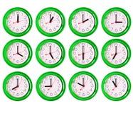 12 geïsoleerde klokvarianten Stock Foto