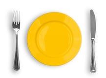 Geïsoleerde mes, gele plaat en vork stock fotografie