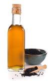 Geïsoleerde Nigella sativa olie Royalty-vrije Stock Afbeelding