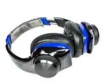 Geïsoleerde oude gebroken hoofdtelefoon Royalty-vrije Stock Afbeeldingen