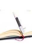 Geïsoleerde pen op het notitieboekje, agenda royalty-vrije stock afbeelding