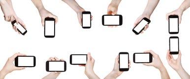Geïsoleerde reeks handen met mobiele telefoons stock foto