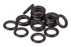 Geïsoleerde reeks zwarte pakkingen Olieverbindingen voor hydraulische cilinders voor Industrieel op witte achtergrond stock foto's