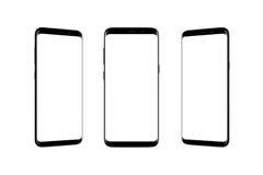 Geïsoleerde slimme telefoon in positie drie stock foto's