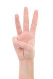 Geïsoleerde vrouwelijke hand die aantal drie tonen Stock Foto