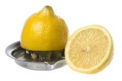 Geïsoleerded citroen en Pers Stock Foto's