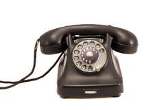 Geïsoleerdee oude zwarte telefoon royalty-vrije stock afbeelding
