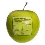 Geïsoleerdee voorwerpen: appel met voedingsinfo stock foto's