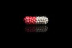 Geïsoleerdel de pillen van de capsule Stock Afbeeldingen