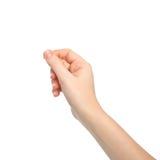 Geïsoleerdel vrouwenhand die een voorwerp houden Royalty-vrije Stock Foto