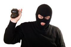 Geïsoleerdem terrorist met twee granaten. Stock Foto