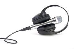 Geïsoleerder hoofdtelefoons en microfoon Stock Foto's