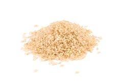 Geïsoleerder stapel ongepelde rijst royalty-vrije stock afbeelding