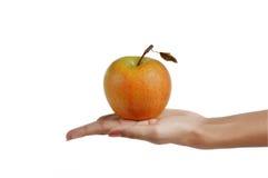 Geïsoleerdes appel op hand Stock Fotografie