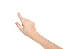 Geïsoleerdee vrouwelijke hand wat betreft het richten aan iets stock foto