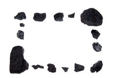 Geïsoleerds frame - steenkool, koolstofgoudklompjes royalty-vrije stock foto