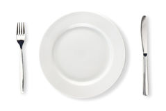 Geïsoleerdw mes, witte plaat en vork Royalty-vrije Stock Fotografie