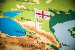 Geórgia identificou por meio de uma bandeira no mapa fotos de stock