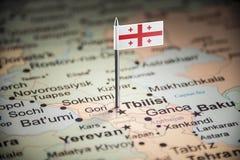 Geórgia identificou por meio de uma bandeira no mapa imagens de stock
