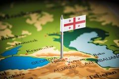 Geórgia identificou por meio de uma bandeira no mapa fotos de stock royalty free