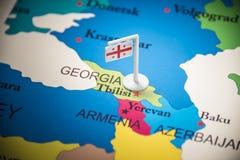 Geórgia identificou por meio de uma bandeira no mapa imagens de stock royalty free