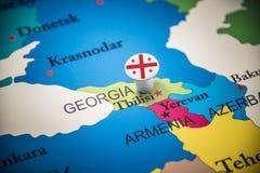 Geórgia identificou por meio de uma bandeira no mapa imagem de stock