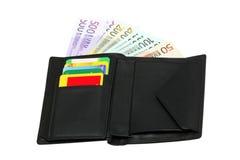 Geöffnete schwarze lederne Geldbörse stockfotos