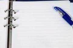 Geöffneter Notizblock und Stift Lizenzfreies Stockbild