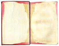 Geöffnetes, beflecktes Buch Lizenzfreie Stockbilder