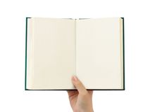 Geöffnetes Buch in der Hand Stockbild