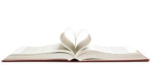 Geöffnetes Buch mit Herzen Stockfotos