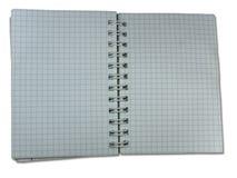 Geöffnetes Leerzeichen quadriertes Notizbuch getrennt Lizenzfreie Stockfotografie