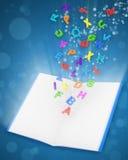 Geöffnetes magisches Buch mit bunten Zeichen Stockfotografie
