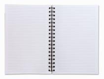 Geöffnetes weißes Notizbuch mit zwei Gesichtern Lizenzfreies Stockfoto