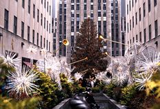 Rockerfeller Centre at Christmas, New York. GE building in the Rockefeller Centre at Christmas with angels browing trumpets in the foreground, New York, USA royalty free stock photography