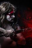 Ge första erfarenhet begreppet, man med det stora svärdet, röda fläckar royaltyfria foton